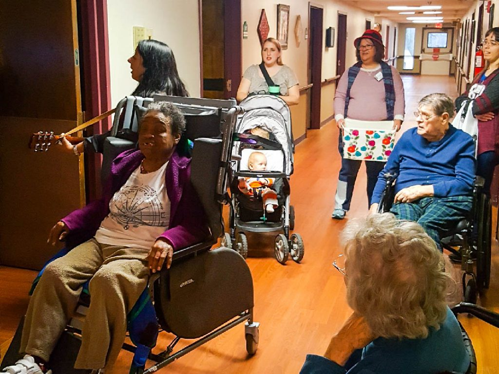 Thursday before Christmas break, we took some of our Anna Club members around the hallways of the nursing home to sing Christmas Carols to each room.